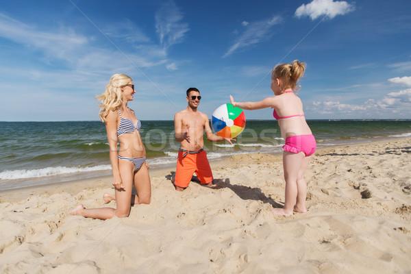 Boldog család játszik felfújható labda tengerpart család Stock fotó © dolgachov