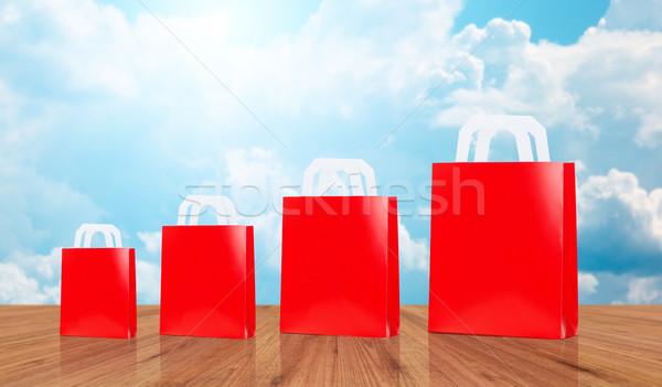 many blank red shopping bags Stock photo © dolgachov