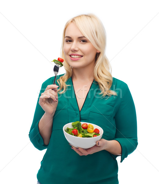 Lächelnd Essen Gemüse Salat gesunde Ernährung Stock foto © dolgachov