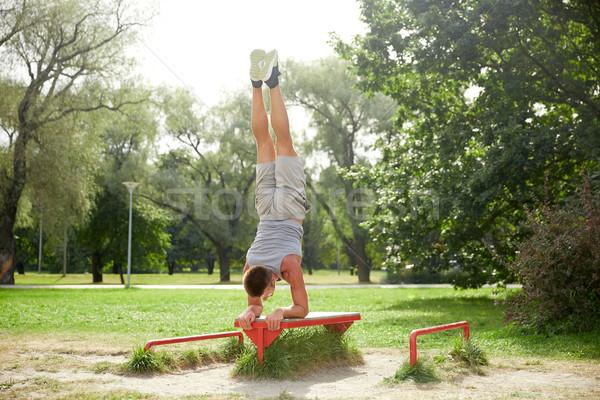 Młody człowiek ławce lata parku fitness Zdjęcia stock © dolgachov