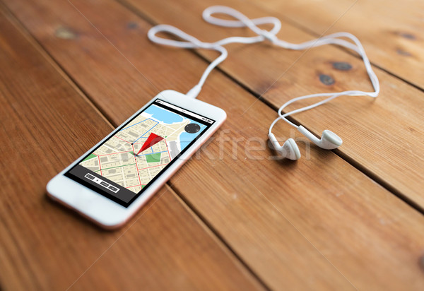 close up of smartphone and earphones on wood Stock photo © dolgachov