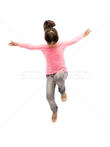 happy little girl jumping in air Stock photo © dolgachov