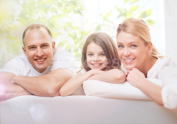 smiling parents and little girl at home Stock photo © dolgachov
