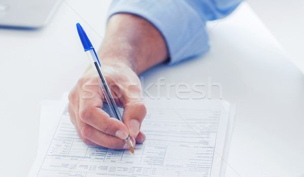 man filling tax form Stock photo © dolgachov
