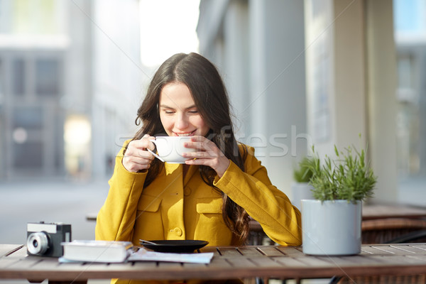 happy tourist woman drinking cocoa at city cafe Stock photo © dolgachov