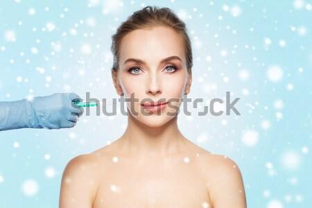 Kadın yüzü el şırınga enjeksiyon insanlar Stok fotoğraf © dolgachov