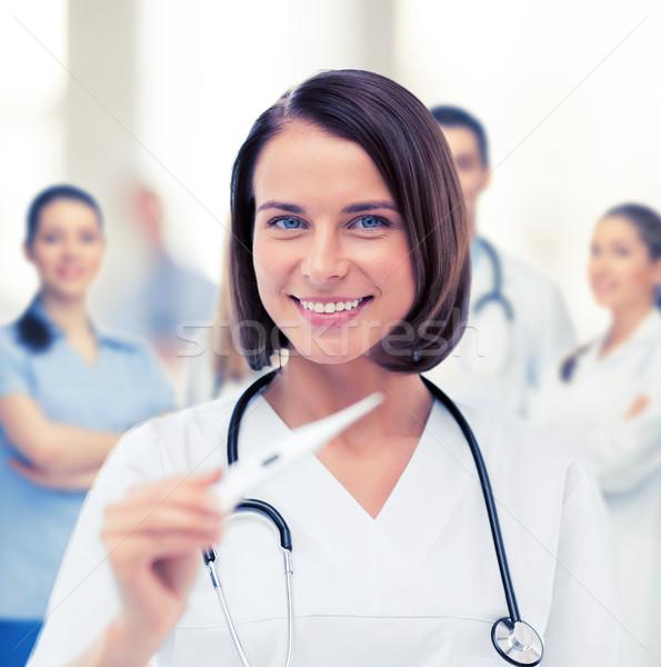 Doktor termometre stetoskop sağlık tıbbi kadın Stok fotoğraf © dolgachov