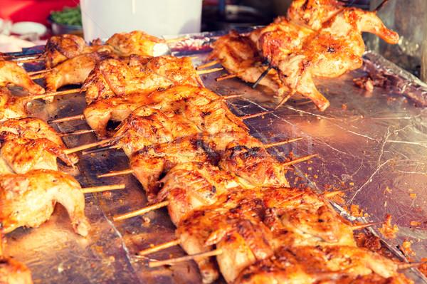 chicken grill at street market Stock photo © dolgachov