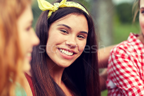 happy young woman with group of friends outdoors Stock photo © dolgachov