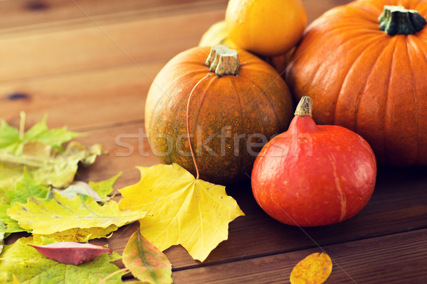 Stock photo: close up of pumpkins on wooden table at home