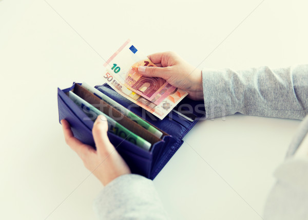 close up of woman hands with wallet and euro money Stock photo © dolgachov