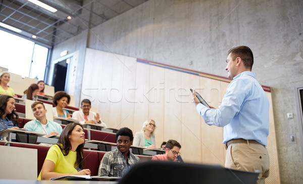 students and teacher with tablet pc at lecture Stock photo © dolgachov