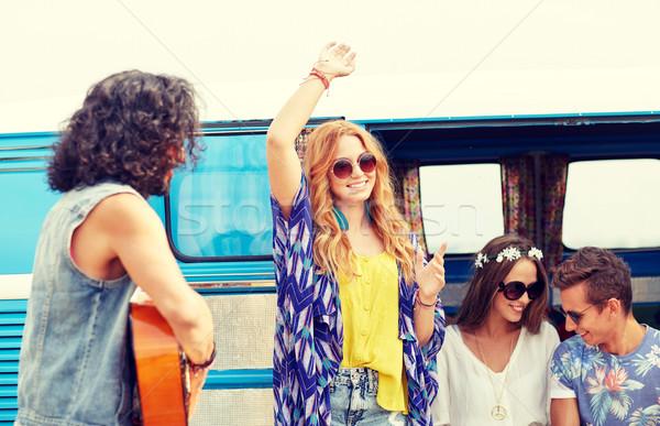 happy hippie friends having fun over minivan car Stock photo © dolgachov