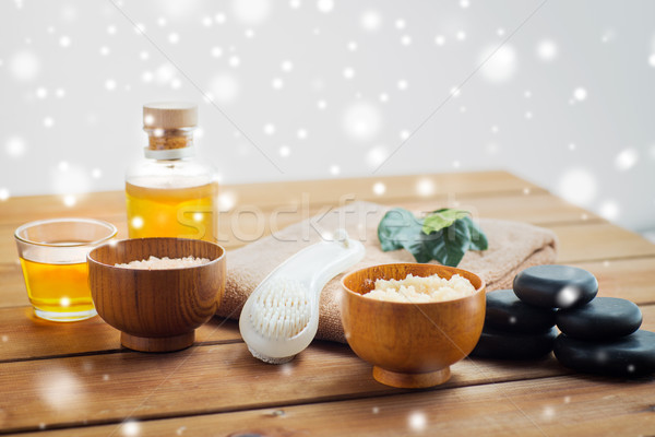body scrub, towel with brush and massage oil Stock photo © dolgachov