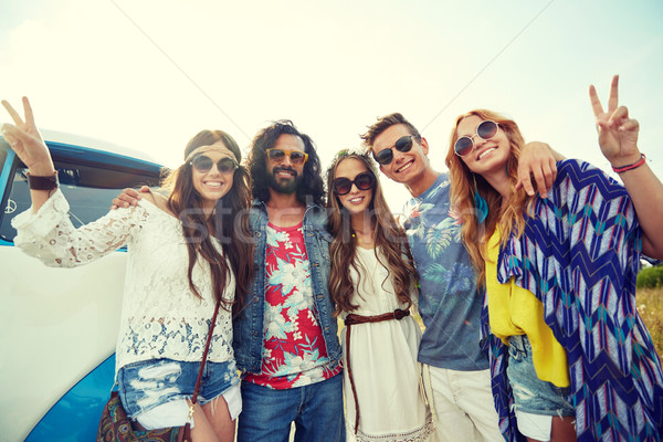 hippie friends over minivan car showing peace sign Stock photo © dolgachov