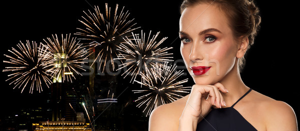 beautiful woman in black over firework lights Stock photo © dolgachov