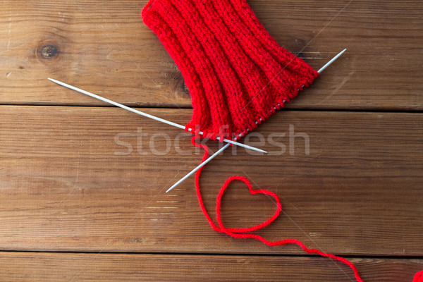 knitting needles and thread in heart shape on wood Stock photo © dolgachov