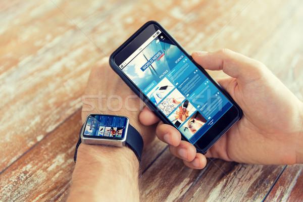 Kezek hírek háló oldal okostelefon óra Stock fotó © dolgachov