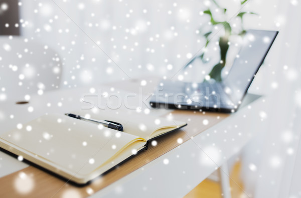 notebook or diary, pen and laptop on office table Stock photo © dolgachov