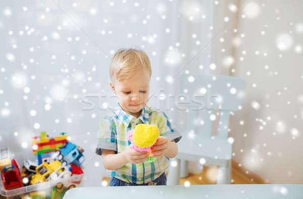happy little baby boy with ball clay at home Stock photo © dolgachov