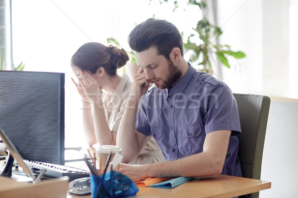 business team with computer and files in office Stock photo © dolgachov