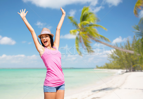 happy young woman in hat on summer beach Stock photo © dolgachov