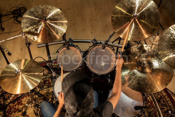 male musician playing drums and cymbals at concert Stock photo © dolgachov