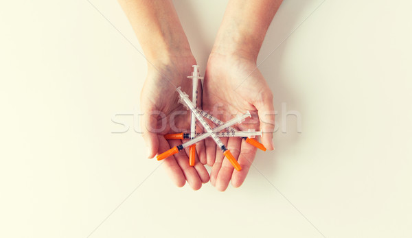 close up of woman hands holding syringes Stock photo © dolgachov