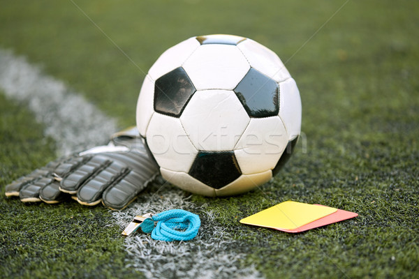 ball, gloves, whistle and cards on soccer field Stock photo © dolgachov