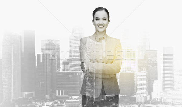 smiling businesswoman over city buildings Stock photo © dolgachov
