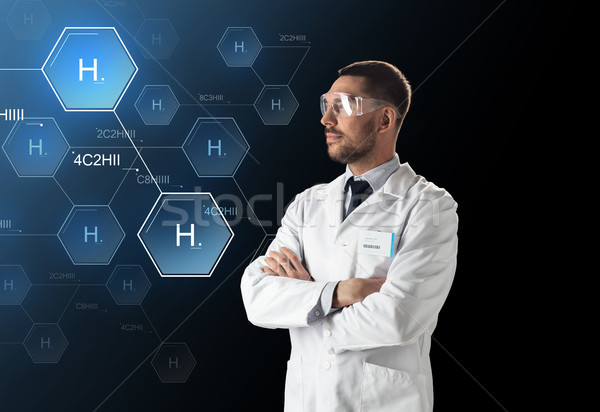 Stock photo: scientist in lab goggles chemical formula