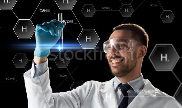 Sonriendo científico gafas de protección tubo de ensayo ciencia futuro Foto stock © dolgachov