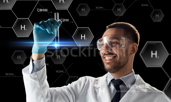Glimlachend wetenschapper stofbril reageerbuis wetenschap toekomst Stockfoto © dolgachov