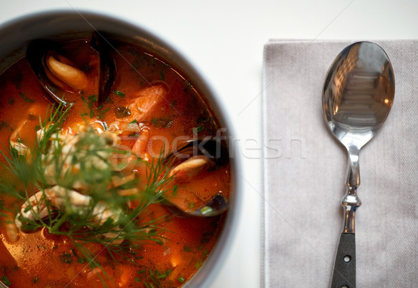 Stock photo: close up of seafood soup with fish and mussels