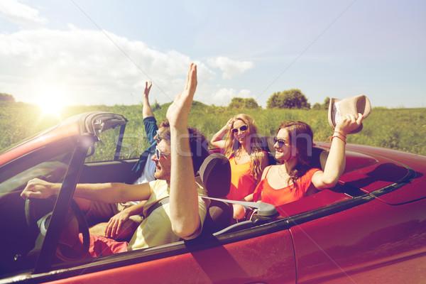 Mutlu arkadaşlar sürücü kabriyole araba ülke Stok fotoğraf © dolgachov