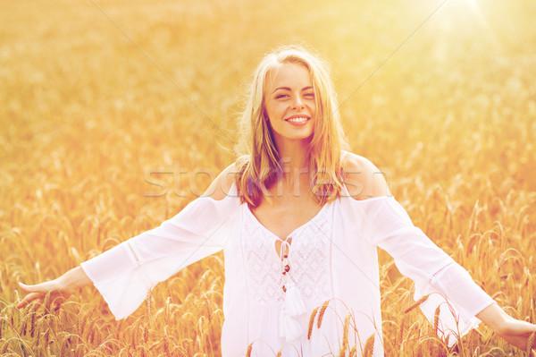 笑みを浮かべて 若い女性 白いドレス 穀物 フィールド 国 ストックフォト © dolgachov
