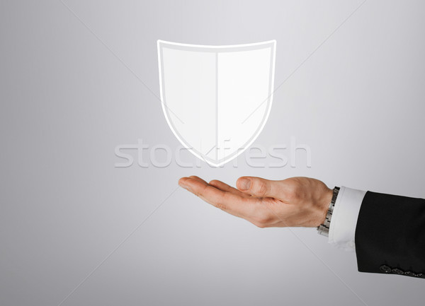 close up of man with virtual antivirus shield icon Stock photo © dolgachov
