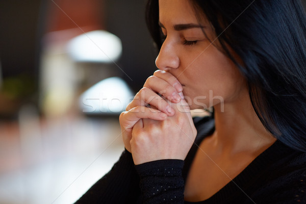 close up of unhappy woman praying god at funeral Stock photo © dolgachov