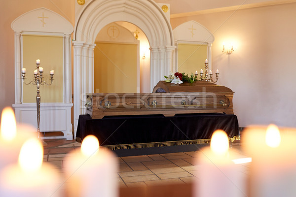 burning candles and coffin in church at funeral Stock photo © dolgachov