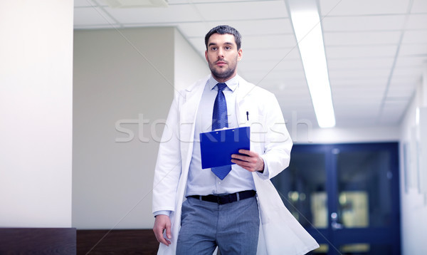 doctor with clipboard walking along hospital Stock photo © dolgachov