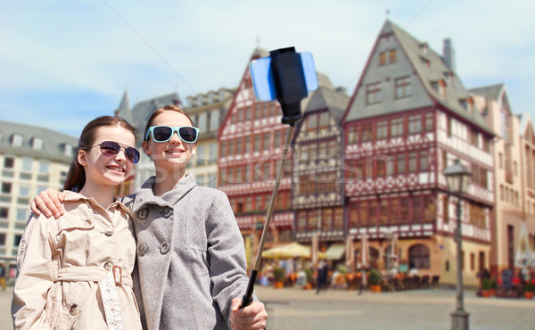 girls with smartphone selfie stick in frankfurt Stock photo © dolgachov