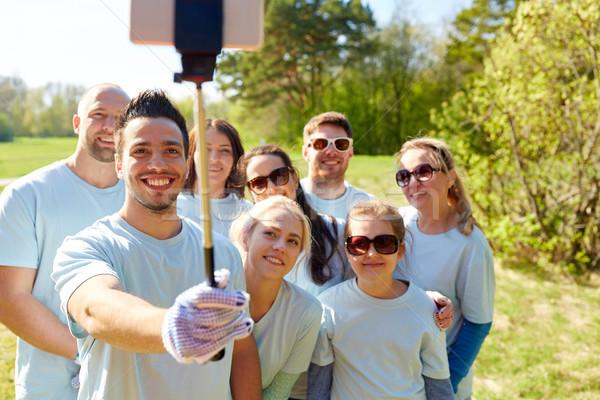 Grupo voluntarios toma voluntariado caridad Foto stock © dolgachov