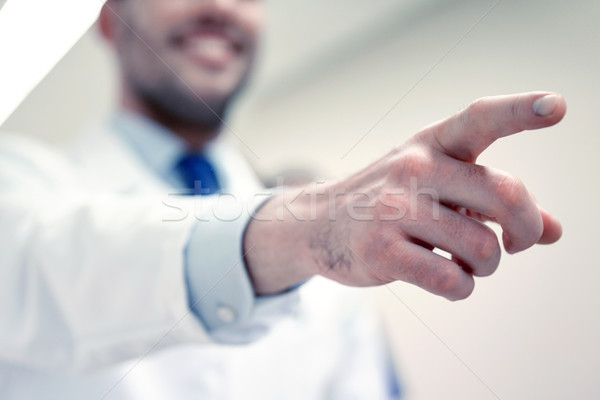 close up of doctor pointing finger at hospital Stock photo © dolgachov