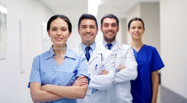 group of happy medics or doctors at hospital Stock photo © dolgachov