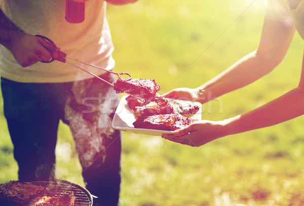 Człowiek gotowania mięsa lata strony grill Zdjęcia stock © dolgachov
