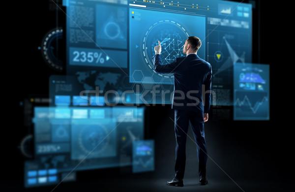 üzletember öltöny megérint virtuális képernyő üzlet Stock fotó © dolgachov