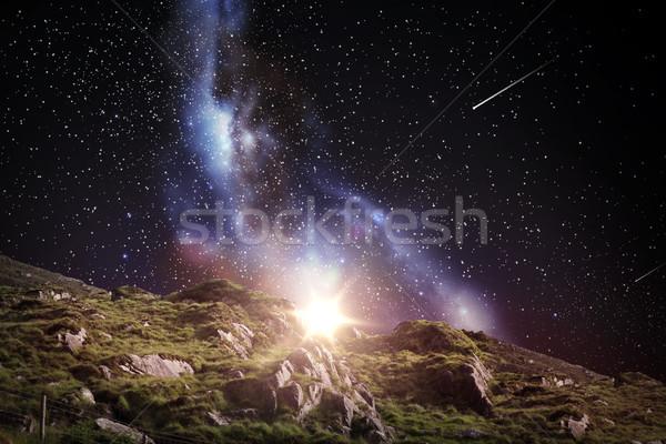 rocky landscape over night sky or space Stock photo © dolgachov