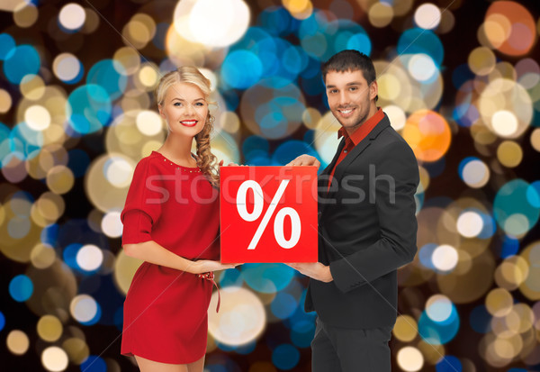 couple with discount sign over christmas lights Stock photo © dolgachov
