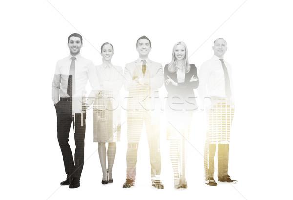 group of smiling businessmen Stock photo © dolgachov