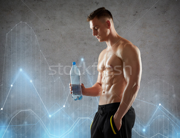 Stock photo: young man or bodybuilder with bottle of water